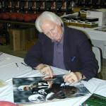 Ken Stabler autographing 16x20 photos for National Sports Distributors