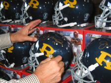 Joe Montana signing Ringgold Helmets at National Sports Distributors