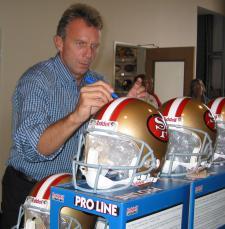 Joe Montana Autographing Helmets for NSD