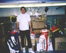 Joe Montana in his garage with items for National Sports Distributors