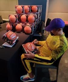 Walt Frazier Signing NSD Basketballs