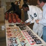 Jerry Rice autographing photos for National Sports Distributors