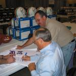 Nolan Ryan autographing jerseys for National Sports Distributors