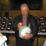 Larry Csonka autographing helmets for National Sports Distributors