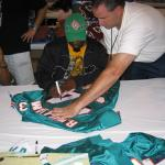 Ricky Williams autographing jerseys for National Sports Distributors