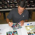 Trent Green autographing photos for National Sports Distributors