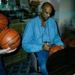 Kareem Abdul Jabbar autographing basketballs for National Sports Distributors