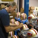 Joe Montana signing helmets for National Sports Distributors