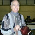Bart Starr autographing Throwback Duke Footballs for National Sports Distributors