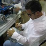 Howie Long signing helmets for National Sports Distributors