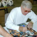George Blanda autographing photos for National Sports Distributors