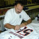 Dick Butkus autographing jerseys for National Sports Distributors