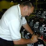 Disck Butkus autographing helmets for National Sports Distributors
