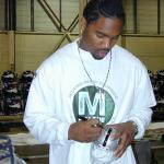 Charles Woodson autographing mini helmets for National Sports Distributors