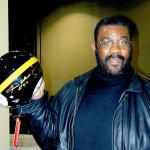 Joe Greene showing off an autographed Steel Curtain Pro Line Helmet