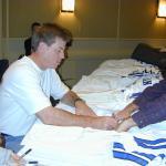 Troy Aikman autographs authentic jerseys for National Sports Distributors