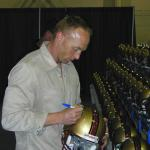 Jeff Garcia autographing helmets for National Sports Distributors