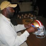 Jerry Rice autographing helmets for National Sports Distributors