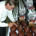 Joe Namath autographing Throwback Duke Footballs for National Sports Distributors