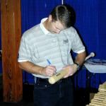 Jeff Kent autographing bats for National Sports Distributors
