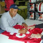 Ronnie Lott autographing jerseys for National Sports Distributors