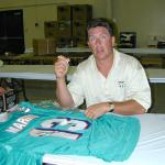 Dan Marino autographing jerseys for National Sports Distributors