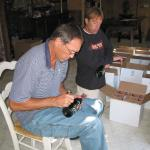 Dwight Clark autographing wine for National Sports Distributors