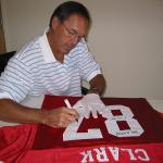 Dwight Clark autographing jerseys for National Sports Distributors