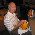 Bart Starr autographing helmets for National Sports Distributors