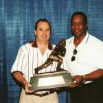 Billy Sims show Rob Hemphill his Heisman Trophy