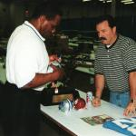 Billy Sims autographs items for National Sports Distributors
