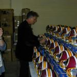 John Riggins autographing hemets for National Sports Distributors