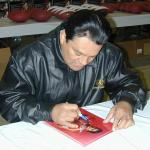 Roberto Duran autographing 8x10 photos for NSD