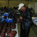 Gale Sayers autographing throwback Duke footballs for National Sports Distributors